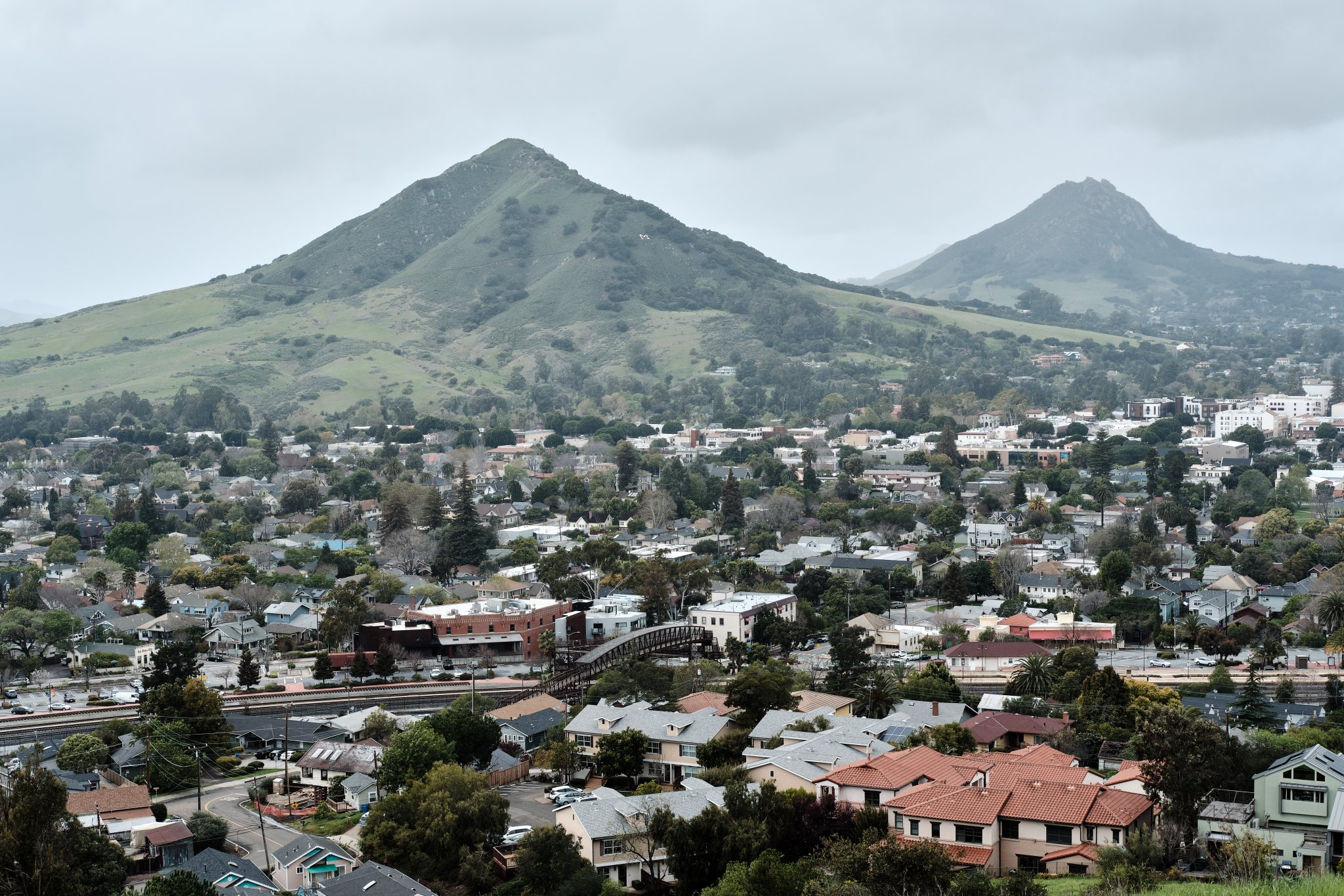 Photo of a San Luis Obispo, California  residential area, the train station, Cerro San Luis, and Bishop Peak.